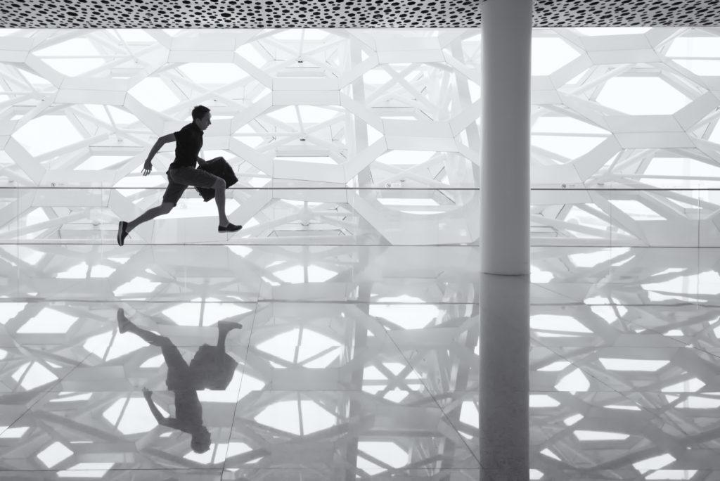 healthy leader runs through airport to catch a plane