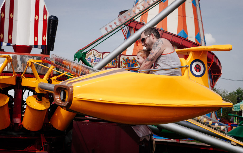 father and son on a carnival ride doing practical succession
