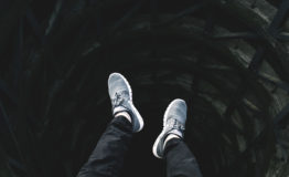 man hangs feet overr the edge of a well thinking about growing his church