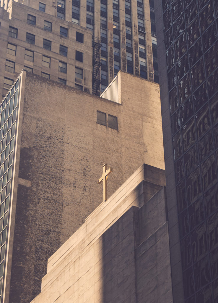cross on the top of a healthy church in the city